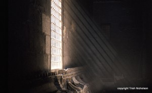 Shafts of light through an old mosque in Luxor, Egypt